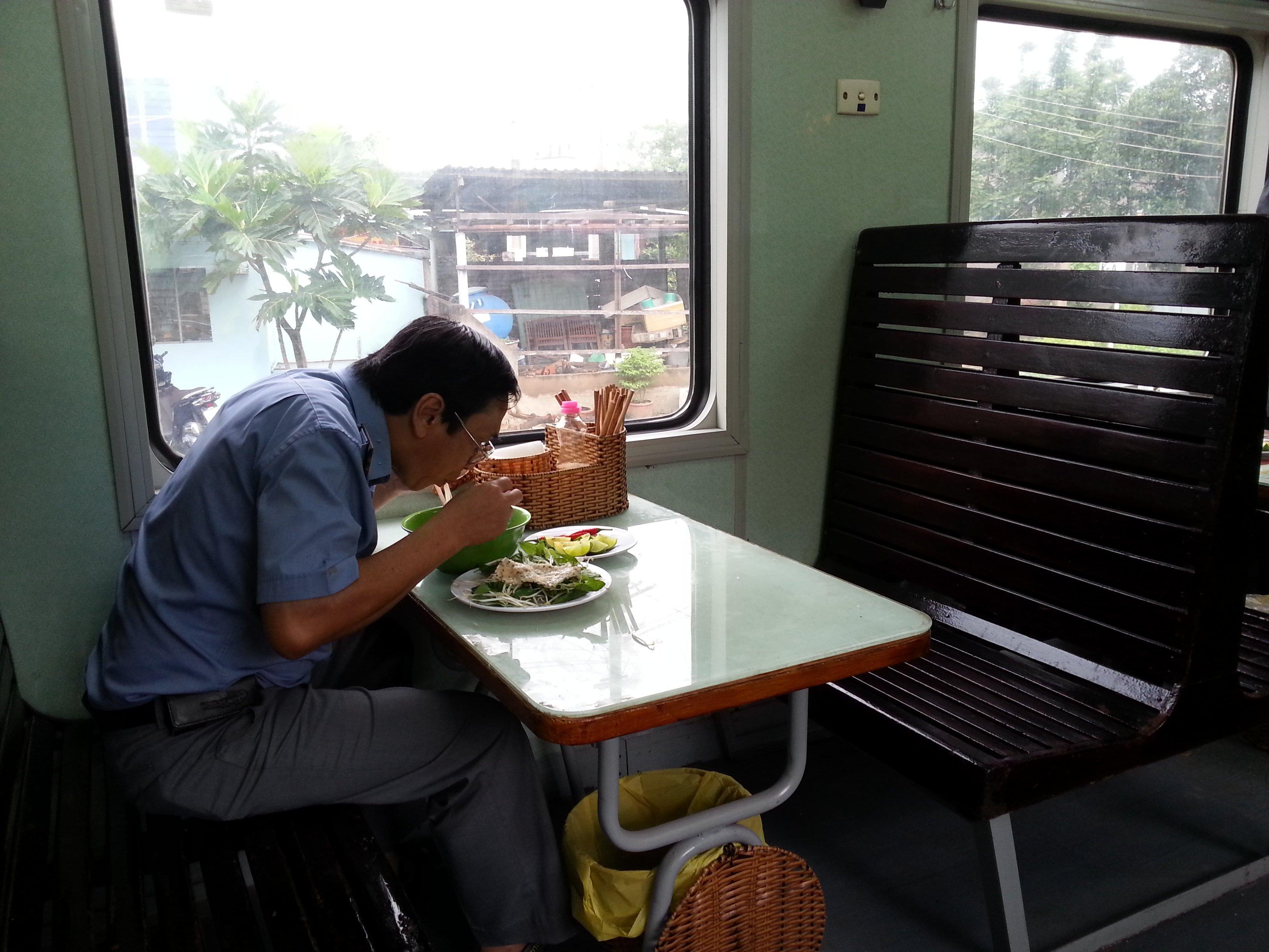 Diner enjoying his noodles on a Vietnam train