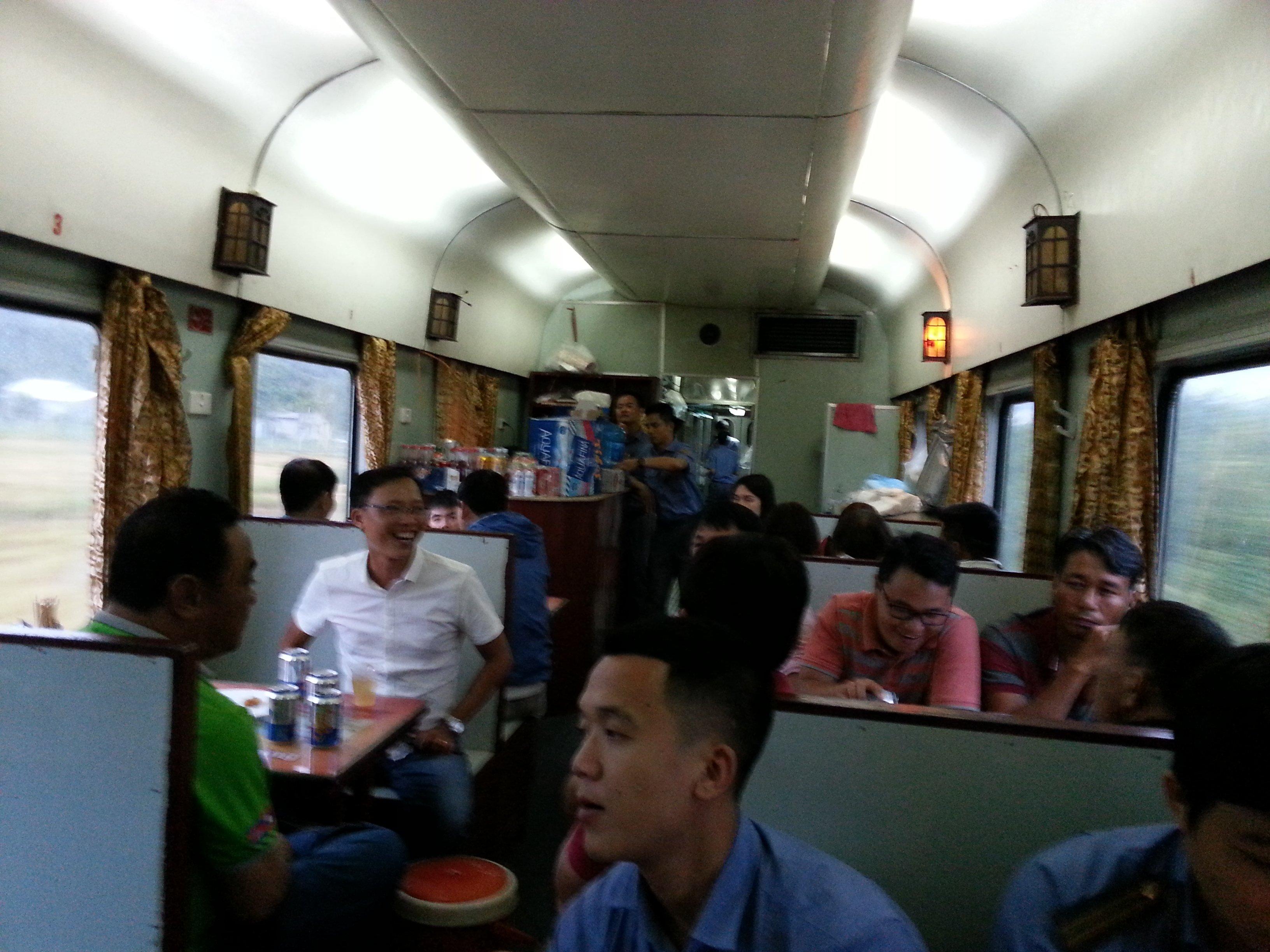 In Vietnam men drink beer on the train