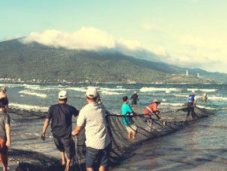 Fishermen on the beach in Da Nang