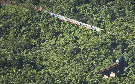 Train negotiating the steep inclines and sharp bends of the Hai Van Pass